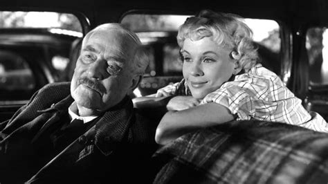 """Still from Bergman's 1957 film """"Wild Strawberries, in which the professor and a young hitchhiker share a fond moment."""