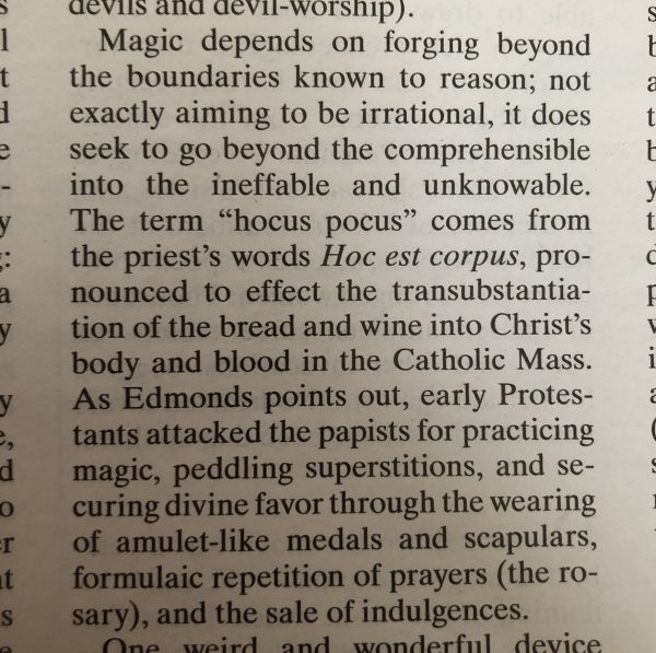 """Clipping from the New York Review of Books explaining the origin of """"hocus pocus"""""""