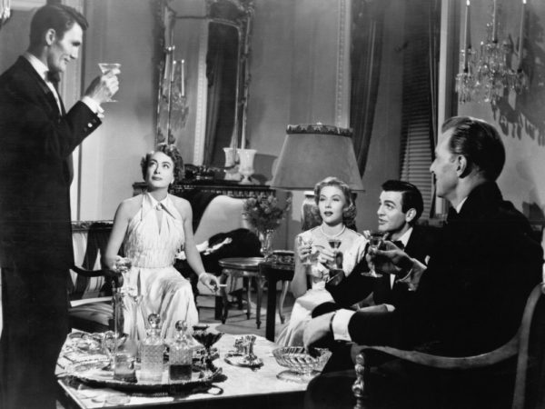 A still from the 1953 noir Sudden Fear, in which several characters have gathered for drinks before dinner.