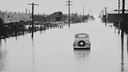 Car abandoned in a flooded street.
