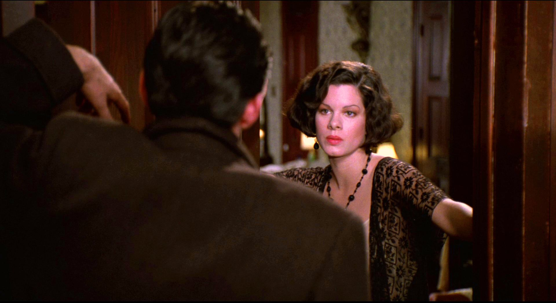 Gabriel Byrne and Marcia Gay Harden in the 1990 film Miller's Crossing