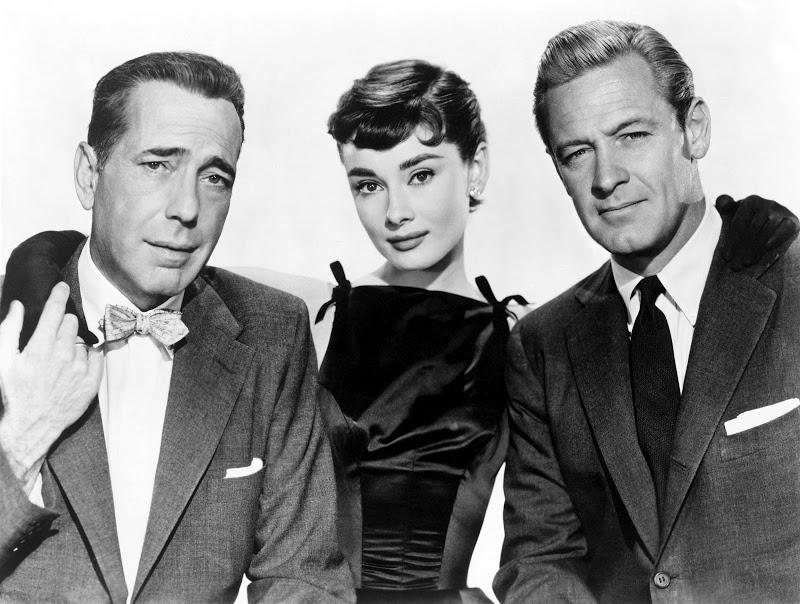 The cast of the 1954 Billy Wilder film Sabrina: Humphrey Bogart, Audrey Hepburn, and William Holden