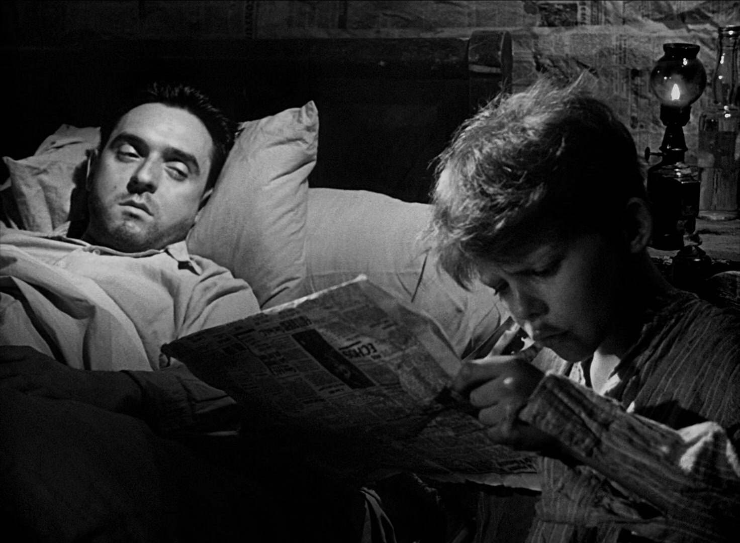 Michel reads to his dying brother in a scene from the 1952 film Forbidden Games
